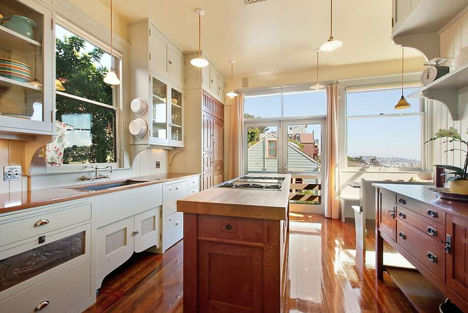 The kitchen has mahogany counters, a soap stone sink and comes with a butcher block. Photo: OpenHomesPhotography.com