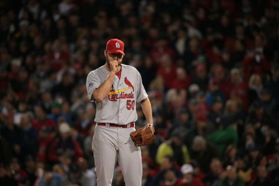 Cardinals pitcher Adam Wainwright blows on his hands between pitches. Photo: David Carson, McClatchy-Tribune News Service