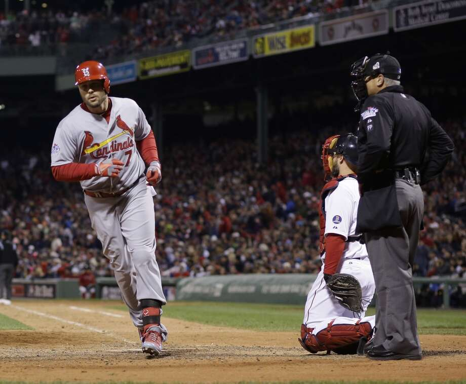 Matt Holliday runs back to the dugout after hitting a home run. Photo: Matt Slocum, Associated Press