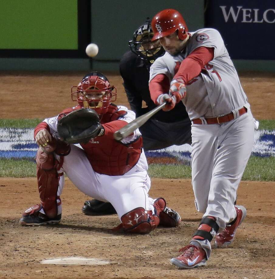 Matt Holliday hits a home run during the ninth inning. Photo: Charlie Riedel, Associated Press