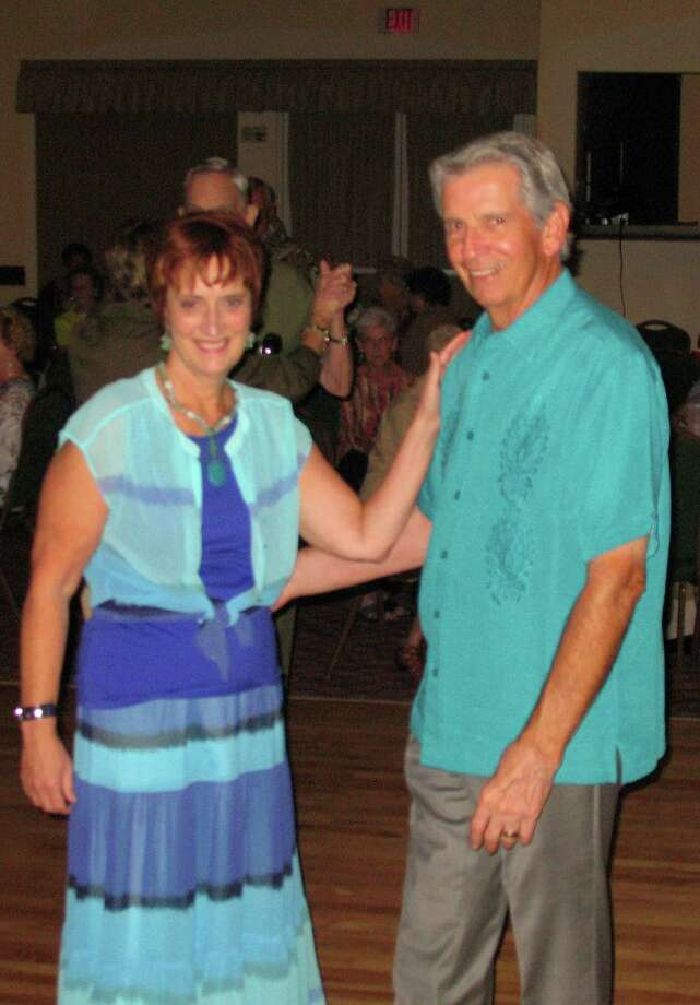 Ron Lauve and his wife, Marita Irmiter, dance together at a recent party.