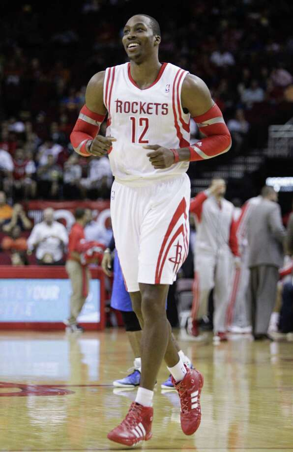 Dwight Howard's addition to the Rockets gives the Spurs a new team to keep an eye on. Photo: Bob Levey / Associated Press