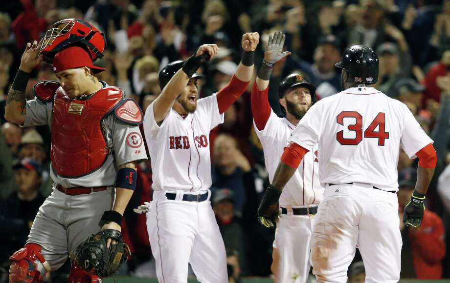 Not a lot went right for catcher Yadier Molina (left) and the Cardinals, who have lost five straight World Series games to the Red Sox going back to 2004. Photo: Elise Amendola / Associated Press