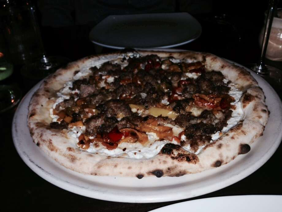 Pizza with sausage and roasted peppers ($19).