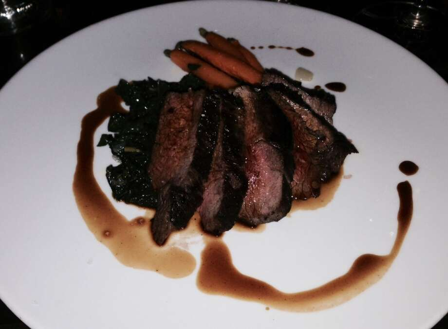 Sirloin steak with braised kale and carrots ($25).