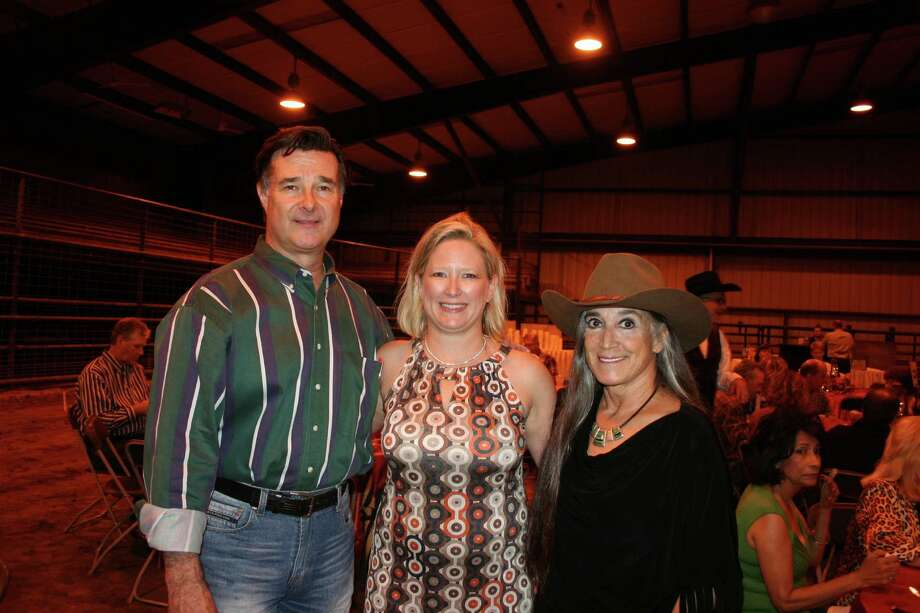 Shannon Bloesch, center, Parks Youth Ranch executive director, welcomed honorary chairs District Attorney John Healey and his wife, Theo. Photo: Joan Vogan