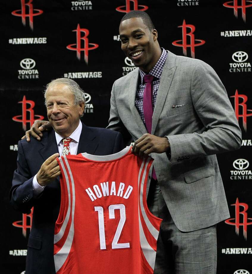 Les Alexander –  Always willing to do whatever it takes to acquire a star player (see Dwight Howard to his right), Les remains committed to adding to the city's collection of NBA championships. Photo: Karen Warren, Houston Chronicle