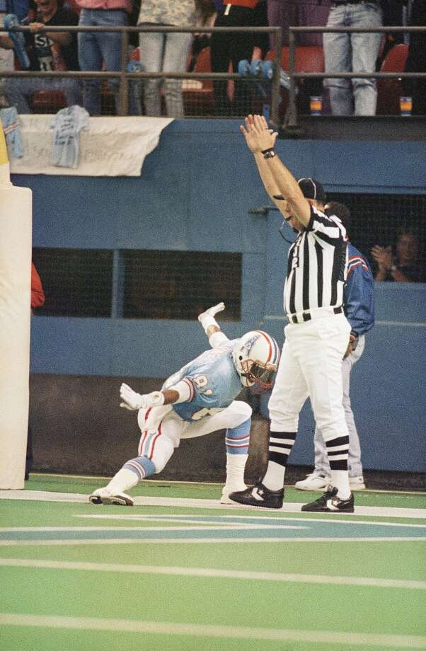 """Ernest Givins – Known for his """"Electric Slide"""" celebration, the spindly little guy could get open, and he could catch, too. He became Warren Moon's go-to guy when a play had to be made. Photo: Richard Carson, Associated Press"""