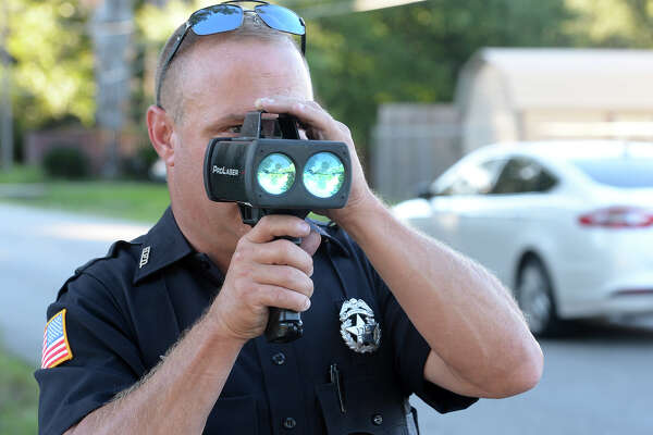 Beaumont Police Officers Bobby Rector spots speeders on Toliver Road Tuesday evening.  Photo taken Tuesday, October 23, 2013 Guiseppe Barranco/The Enterprise
