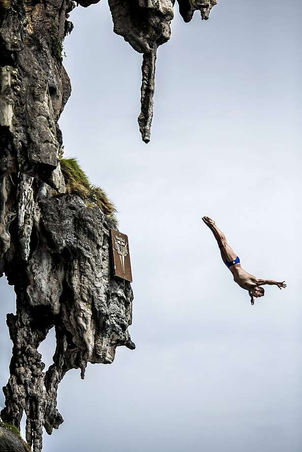 In this handout image provided by Red Bull, Michal Navratil of the Czech Republic dives from a 25 metre rock at Viking Caves in the Andaman Sea during competition on the fifth day of the final stop of the 2013 Red Bull Cliff Diving World Series on October 24, 2013 at Phi Phi Island, Thailand. Photo: Handout, Red Bull Via Getty Images