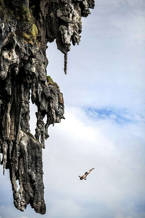 In this handout image provided by Red Bull, Steven LoBue of the USA dives from a 25 metre rock at Viking Caves in the Andaman Sea during competition on the fifth day of the final stop of the 2013 Red Bull Cliff Diving World Series on October 24, 2013 at Phi Phi Island, Thailand. Photo: Handout, Red Bull Via Getty Images