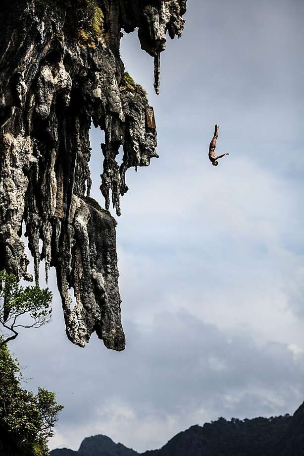 In this handout image provided by Red Bull, Artem Silchenko of Russia dives from a 25 metre rock at Viking Caves in the Andaman Sea during competition on the fifth day of the final stop of the 2013 Red Bull Cliff Diving World Series on October 24, 2013 at Phi Phi Island, Thailand. Photo: Handout, Red Bull Via Getty Images