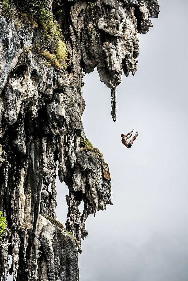 In this handout image provided by Red Bull, Andy Jones of the USA dives from a 25 metre rock at Viking Caves in the Andaman Sea during competition on the fifth day of the final stop of the 2013 Red Bull Cliff Diving World Series on October 24, 2013 at Phi Phi Island, Thailand. Photo: Handout, Red Bull Via Getty Images