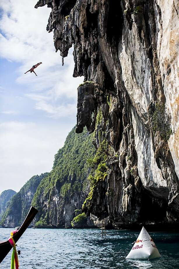 In this handout image provided by Red Bull, Alain Kohl of Luxembourg dives from a 25 metre rock at Viking Caves in the Andaman Sea during competition on the fifth day of the final stop of the 2013 Red Bull Cliff Diving World Series on October 24, 2013 at Phi Phi Island, Thailand. Photo: Handout, Red Bull Via Getty Images