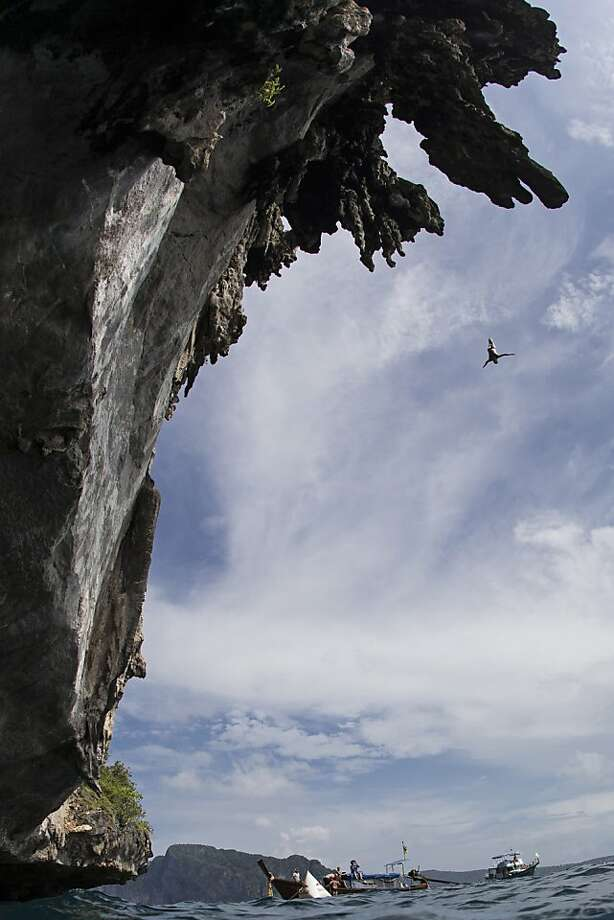In this handout image provided by Red Bull, Kent De Mond of the USA dives from a 25 metre rock at Viking Caves in the Andaman Sea during competition on the fifth day of the final stop of the 2013 Red Bull Cliff Diving World Series on October 24, 2013 at Phi Phi Island, Thailand. Photo: Handout, Red Bull Via Getty Images