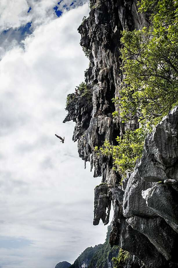 In this handout image provided by Red Bull, Anatoliy Shabotenko of the Ukraine dives from a 25 metre rock at Viking Caves in the Andaman Sea during competition on the fifth day of the final stop of the 2013 Red Bull Cliff Diving World Series on October 24, 2013 at Phi Phi Island, Thailand. Photo: Handout, Red Bull Via Getty Images