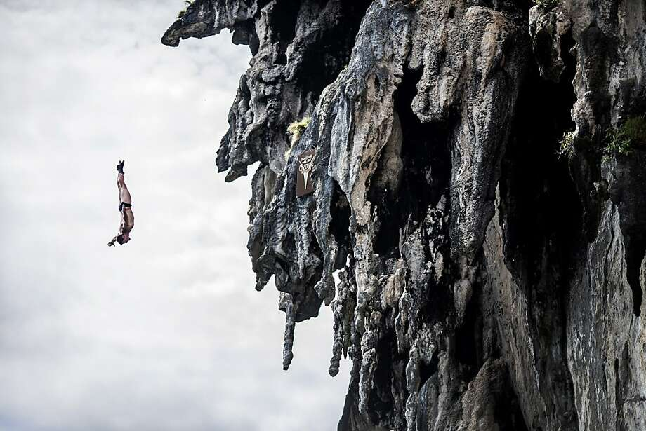 In this handout image provided by Red Bull, David Colturi of the USA dives from a 25 metre rock at Viking Caves in the Andaman Sea during competition on the fifth day of the final stop of the 2013 Red Bull Cliff Diving World Series on October 24, 2013 at Phi Phi Island, Thailand. Photo: Handout, Red Bull Via Getty Images