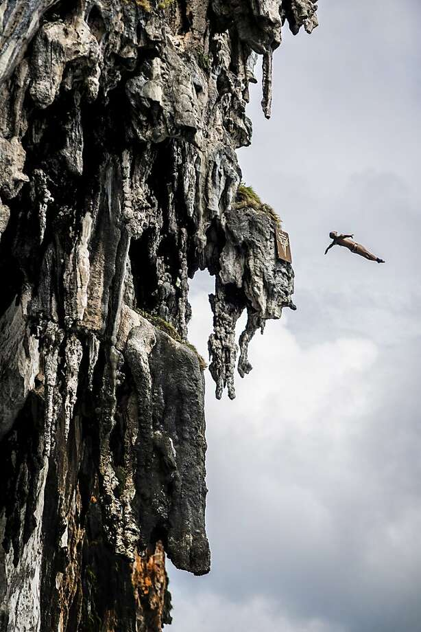 In this handout image provided by Red Bull, Orlando Duque of Colombia dives from a 25 metre rock at Viking Caves in the Andaman Sea during competition on the fifth day of the final stop of the 2013 Red Bull Cliff Diving World Series on October 24, 2013 at Phi Phi Island, Thailand. Photo: Handout, Red Bull Via Getty Images