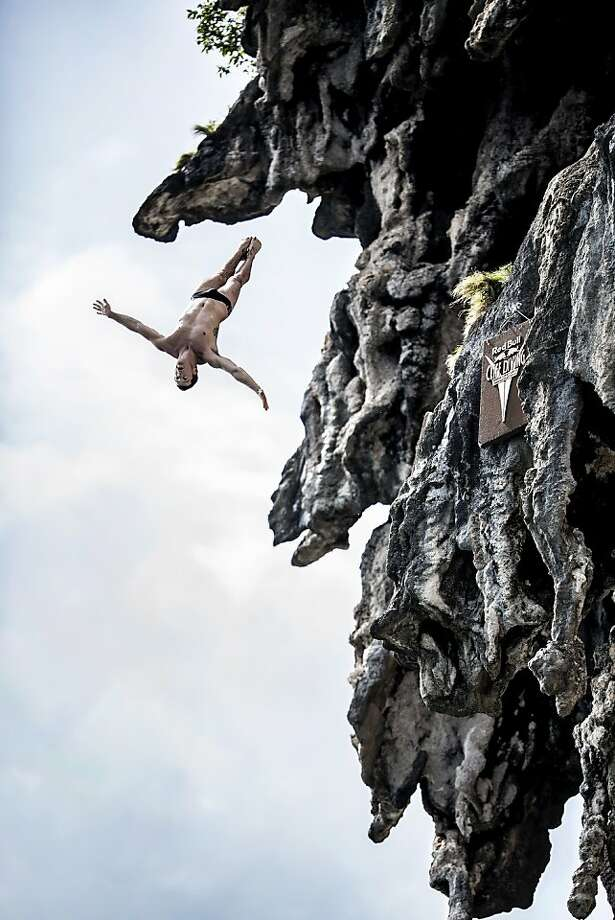 Steven LoBue of the USA dives from a 25 metre rock at Viking Caves in the Andaman Sea during competition on the fifth day of the final stop of the 2013 Red Bull Cliff Diving World Series on October 24, 2013 at Phi Phi Island, Thailand. Photo: Red Bull, Getty Images