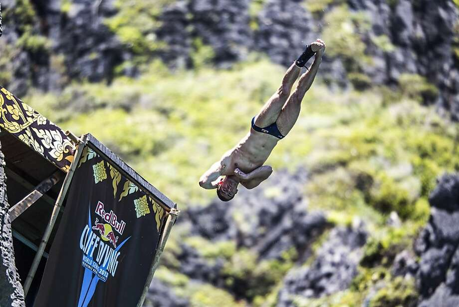In this handout image provided by Red Bull, David Colturi of the USA dives from the 27 metre platform at Maya Bay in the Andaman Sea during the final stop of the 2013 Red Bull Cliff Diving World Series on October 22, 2013 at Phi Phi Island, Thailand. Photo: Handout, Red Bull Via Getty Images