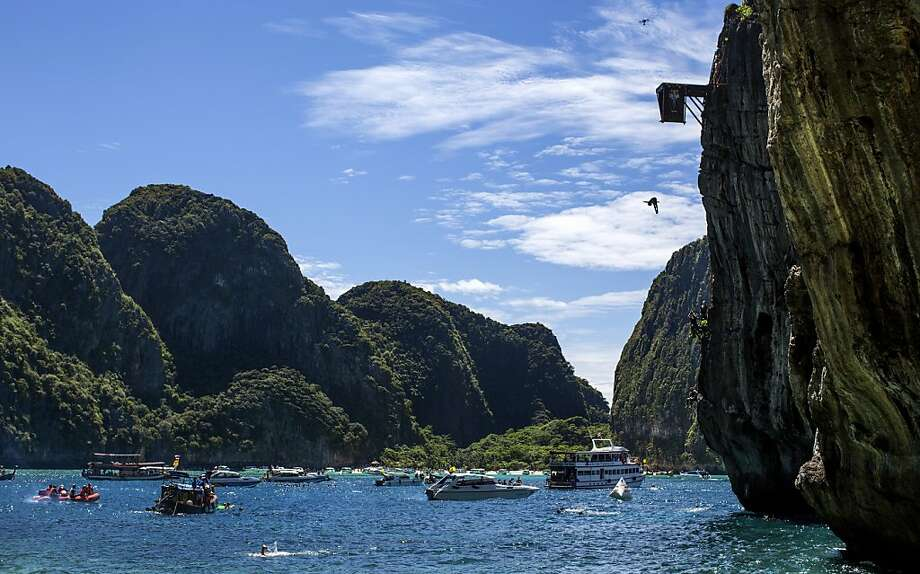 In this handout image provided by Red Bull, Gary Hunt of the UK dives from the 27 metre platform at Maya Bay in the Andaman Sea during the final stop of the 2013 Red Bull Cliff Diving World Series on October 22, 2013 at Phi Phi Island, Thailand. Photo: Handout, Red Bull Via Getty Images