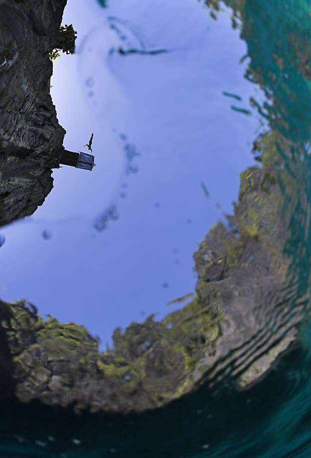 In this handout image provided by Red Bull, Michal Navratil of the Czech Republic dives from the 27 metre platform at Maya Bay in the Andaman Sea during the final stop of the 2013 Red Bull Cliff Diving World Series on October 22, 2013 at Phi Phi Island, Thailand. Photo: Handout, Red Bull Via Getty Images