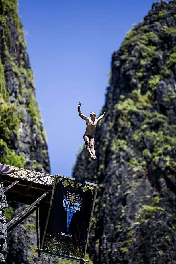 In this handout image provided by Red Bull, Anatoliy Shabotenko of the Ukraine dives from the 27 metre platform at Maya Bay in the Andaman Sea during the final stop of the 2013 Red Bull Cliff Diving World Series on October 22, 2013 at Phi Phi Island, Thailand. Photo: Handout, Red Bull Via Getty Images