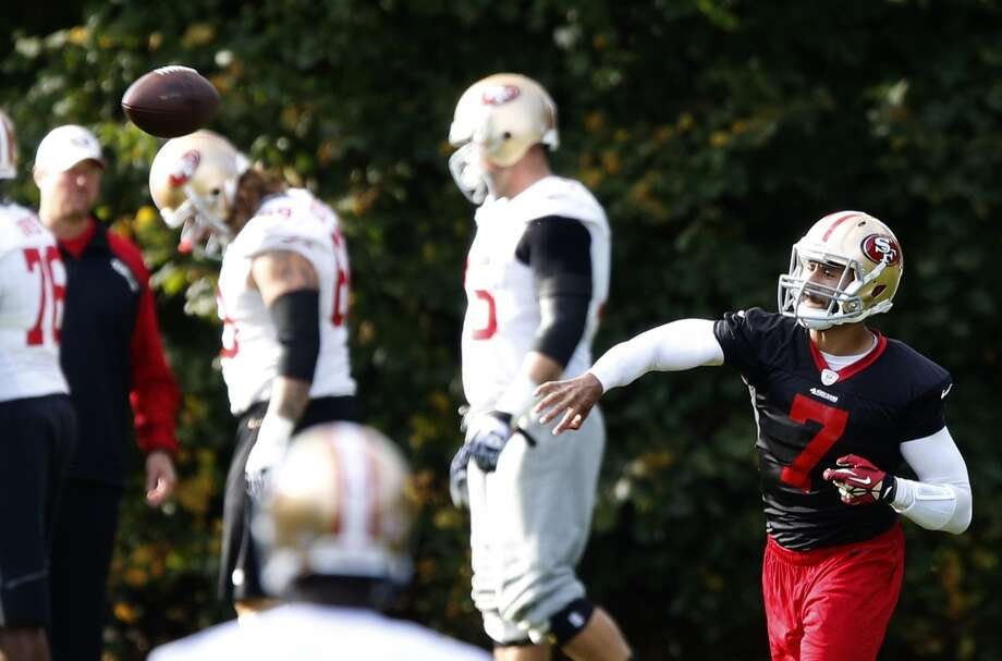 San Francisco 49ers quarterback Colin Kaepernick passes during an NFL training session at the Grove Hotel in Chandler's Cross, England. Photo: Matt Dunham, Associated Press