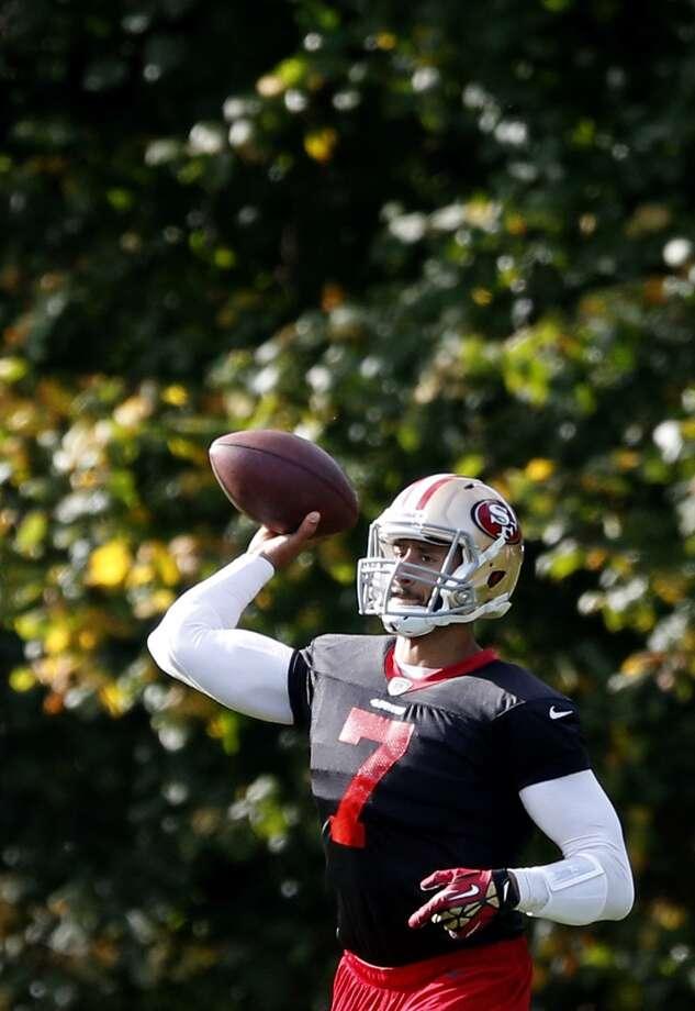 San Francisco 49ers quarterback Colin Kaepernick makes a pass during an NFL training session at the Grove Hotel in Chandler's Cross, England. Photo: Matt Dunham, Associated Press