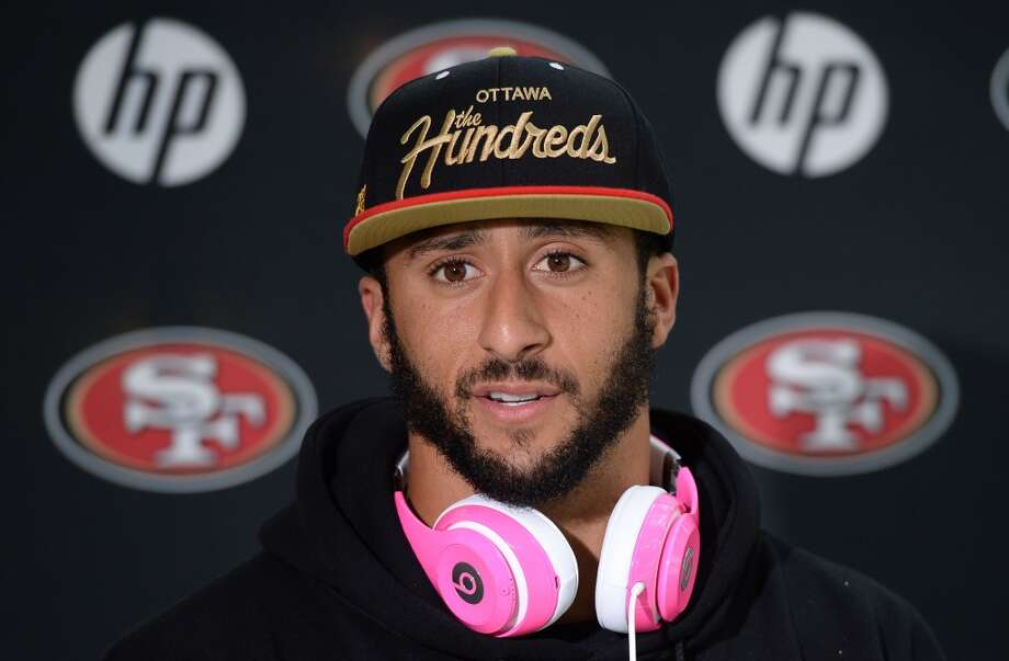 San Francisco 49ers  quarterback Colin Kaepernick  listens  during a press conference in Watford, north of London. Photo: Dave Shopland, Associated Press