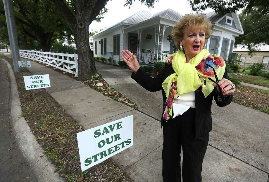 Madeline Martino, who has lived at 217 W. Johnson at the corner of S. Main for her whole life, 73 years, is against the proposed H-E-B closure of S. Main in front of its Headquarters, Friday, Oct. 18, 2013. Photo: BOB OWEN, San Antonio Express-News / © 2012 San Antonio Express-News