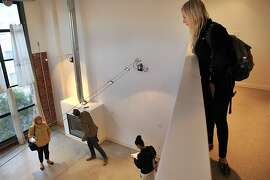 Leah Volger, 25, right, listens in as Real Estate Agent Jeanne Zimmerman, left, discusses details of the loft with Seth Skiles, 33, center, and Maria Skiles, 30, from the first floor during an open house October 23, 2013 in Howard Centre in San Francisco, Calif. The one-bedroom, two-bathroom loft located on 1233 Howard Street is marked at $3800 a month. Volger, who was looking for her and her boyfriend, says she thinks it's really difficult if someone wants to live alone in the city because of how high rent rates are.