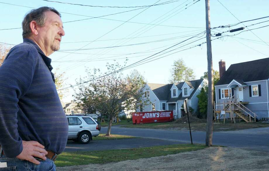 Ken Lee, whose family moved to Rhoda Avenue 50 years ago, looks out on a street undergoing a transformation following Superstorm Sandy. Photo: Genevieve Reilly / Fairfield Citizen