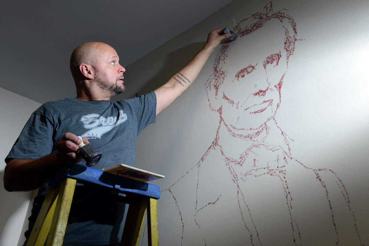 Artist Roberto Martinez creates the image of Abraham Lincoln out of time stamps in the vault on the third floor of McLevy Hall in downtown Bridgeport, Conn. The historic building will become a new home for artists beginning on Nov. 7 thanks to a state-city grant-funded partnership that will provide space for artists to create and sell their artwork from inside the building.