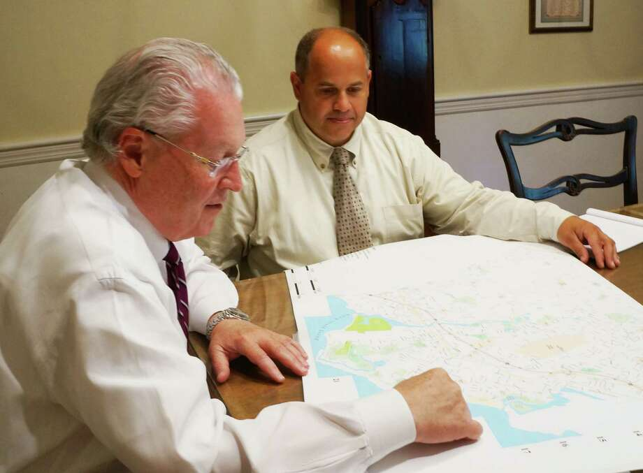 First Selectman Mike Tetreau, left, and Public Works Director Joseph Michelangelo look over a map of the beach neighborhoods. The town is exploring ways to prevent or minimize future storm flooding. Photo: Genevieve Reilly / Fairfield Citizen
