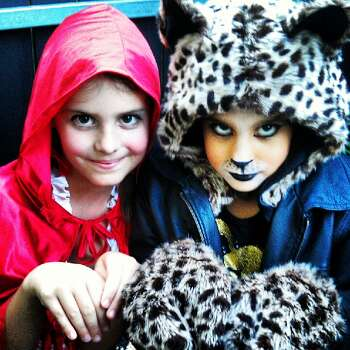 Little Red Riding Hood and her cheeta sis Helena, preparing for Halloween.