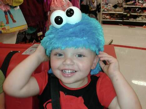 This is my son Aiden trying on a Cookie Monster costume. 