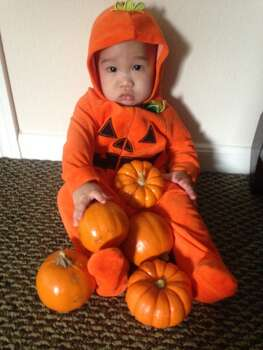 "Meet 8 month old Matthias. Since he is always his Daddy and Mommy's precious little ""pumpkin"", dressing up as a pumpkin while celebrating his 1st Halloween surely works!