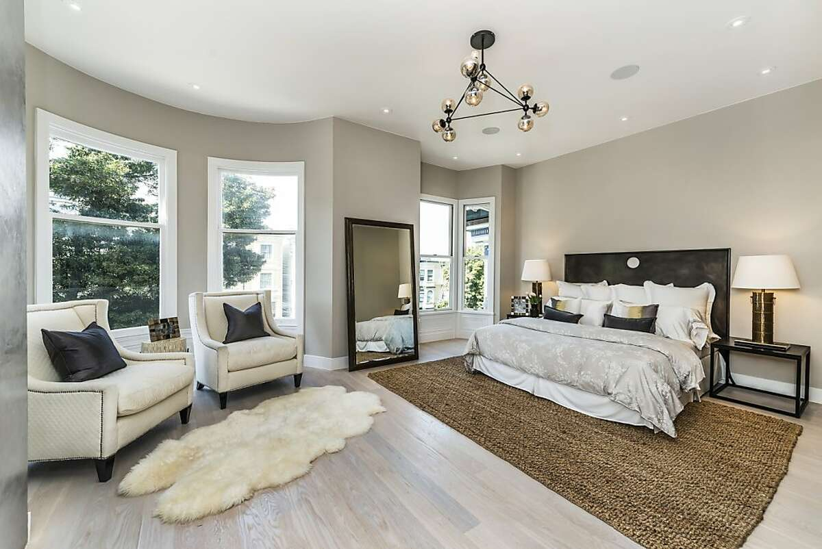 The master suite is one of three bedrooms set on the upper level of 1244 Masonic Ave.