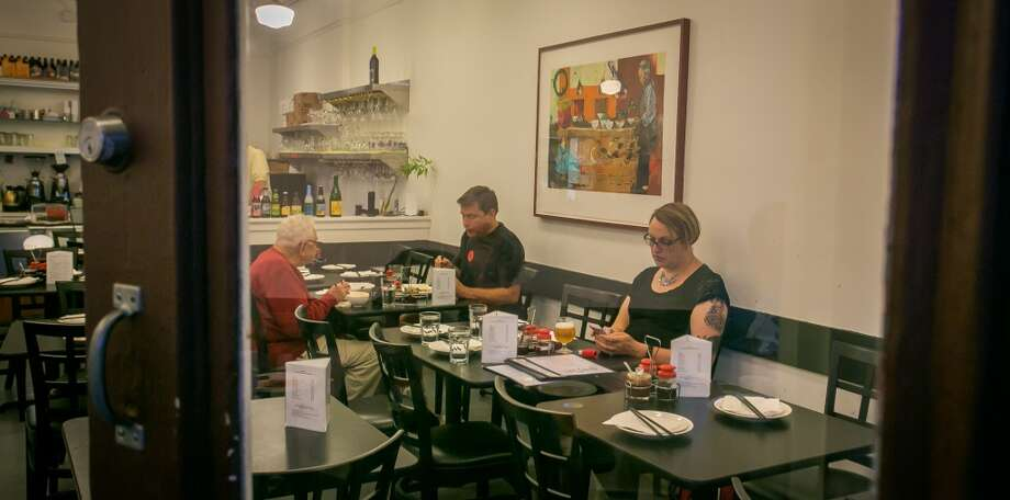 People enjoy dinner at Mama Ji's in San Francisco. Photo: John Storey, Special To The Chronicle