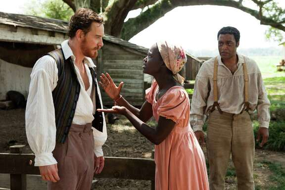 "Michael Fassbender, left, Lupita Nyong'o and Chiwetel Ejiofor star in ""12 Years a Slave."""