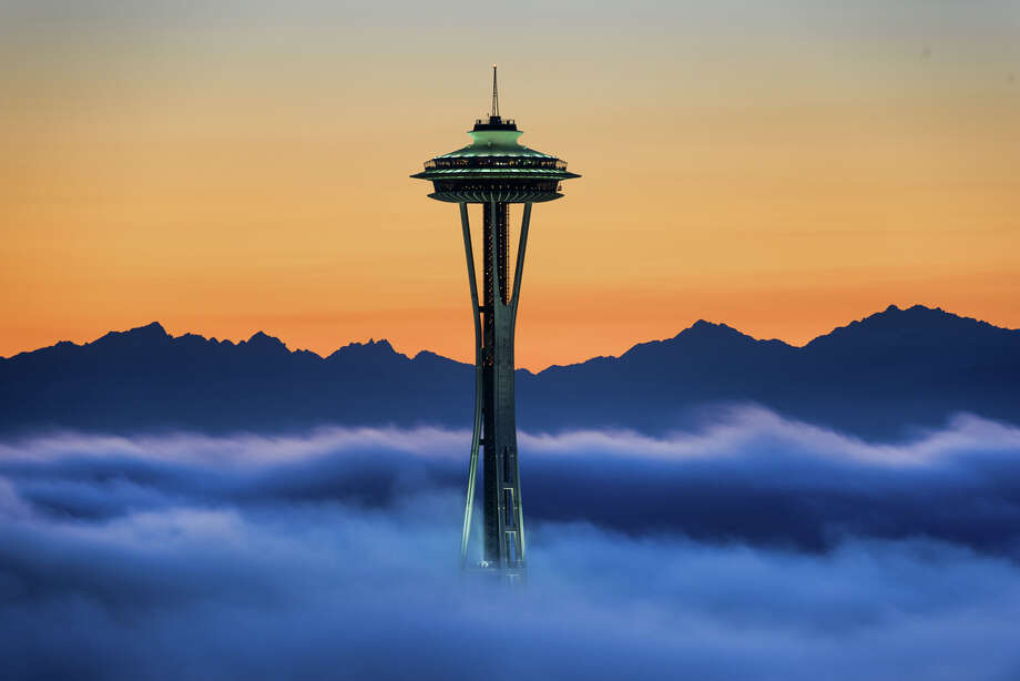 The Space Needle and Olympic Mountains are seen in this photo from Wednesday, shared by Tim Durkan.  See more of his work here. Photo: TIM DURKAN, COURTESY PHOTO / COURTESY PHOTO