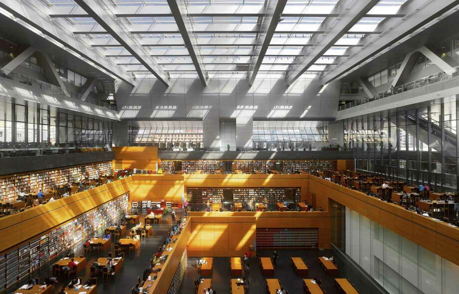 "The National Library of China, 2008. Beijing, China. Designed by the German firm Jürgen Engel Architects, the library has a reading room that is roughly square on plan and steps downwards, getting progressively smaller at each level.From ""The Library: A World History"" by Cambridge University architectural historian James Campbell and photographer Will Pryce. Photo: Will Pryce / This picture can only be used with prior permission and/or agreement of fees with Will Pryce."