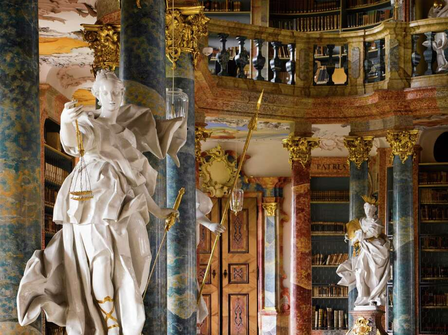 "Wiblingen Abbey Library, 1744. Wiblingen, Germany. The statues, which represent the virtues and the disciplines, are timber, painted to look like marble, and the columns are timber finished in scagliola.From ""The Library: A World History"" by Cambridge University architectural historian James Campbell and photographer Will Pryce. Photo: Will Pryce"