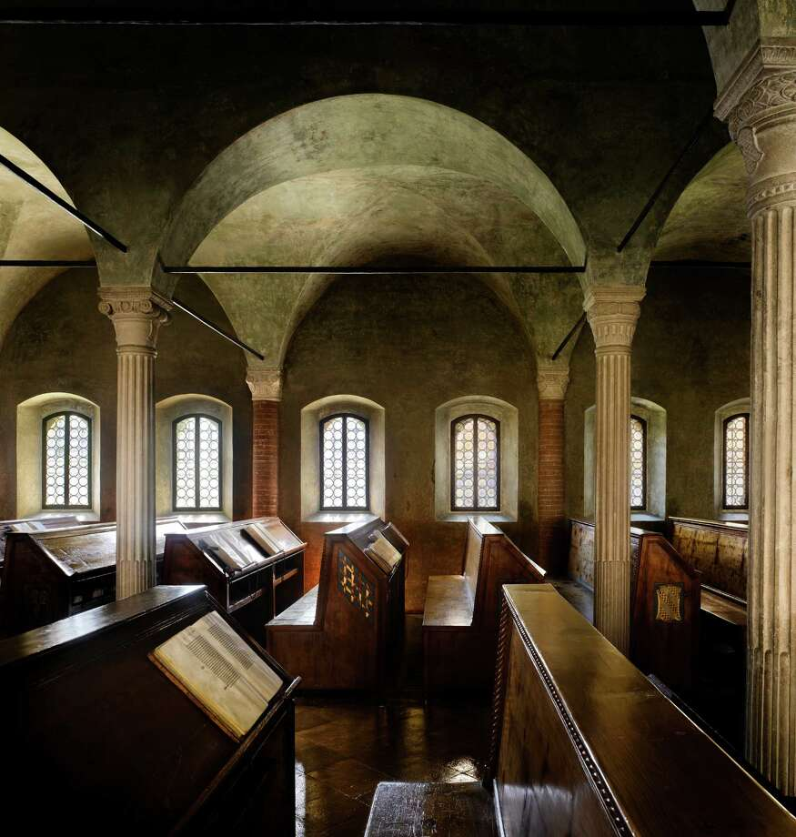 "Biblioteca Malatestiana, 1452. Cesena, Italy. The room is lit by small windows with thick bull's-eye glass that provides a diffuse green light.From ""The Library: A World History"" by Cambridge University architectural historian James Campbell and photographer Will Pryce. Photo: Will Pryce / This picture can only be used with prior permission and/or agreement of fees with Will Pryce."