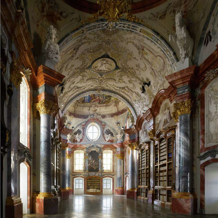 """Altenburg Abbey Library, 1742. Altenburg, Austria. This view down the second half of the library from the central dome (opposite) gives a  clear idea of the room's size.From """"The Library: A World History"""" by Cambridge University architectural historian James Campbell and photographer Will Pryce. Photo: Will Pryce / This picture can only be used with prior permission and/or agreement of fees with Will Pryce."""