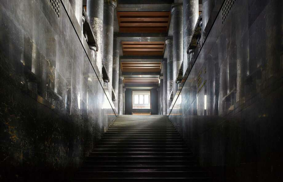 "The National Library of Slovenia, 1941. Ljubljana, Slovenia. The main staircase, made of black marble, rises from the entrance to the hall in front of the reading room.From ""The Library: A World History"" by Cambridge University architectural historian James Campbell and photographer Will Pryce. Photo: Will Pryce / This picture can only be used with prior permission and/or agreement of fees with Will Pryce."