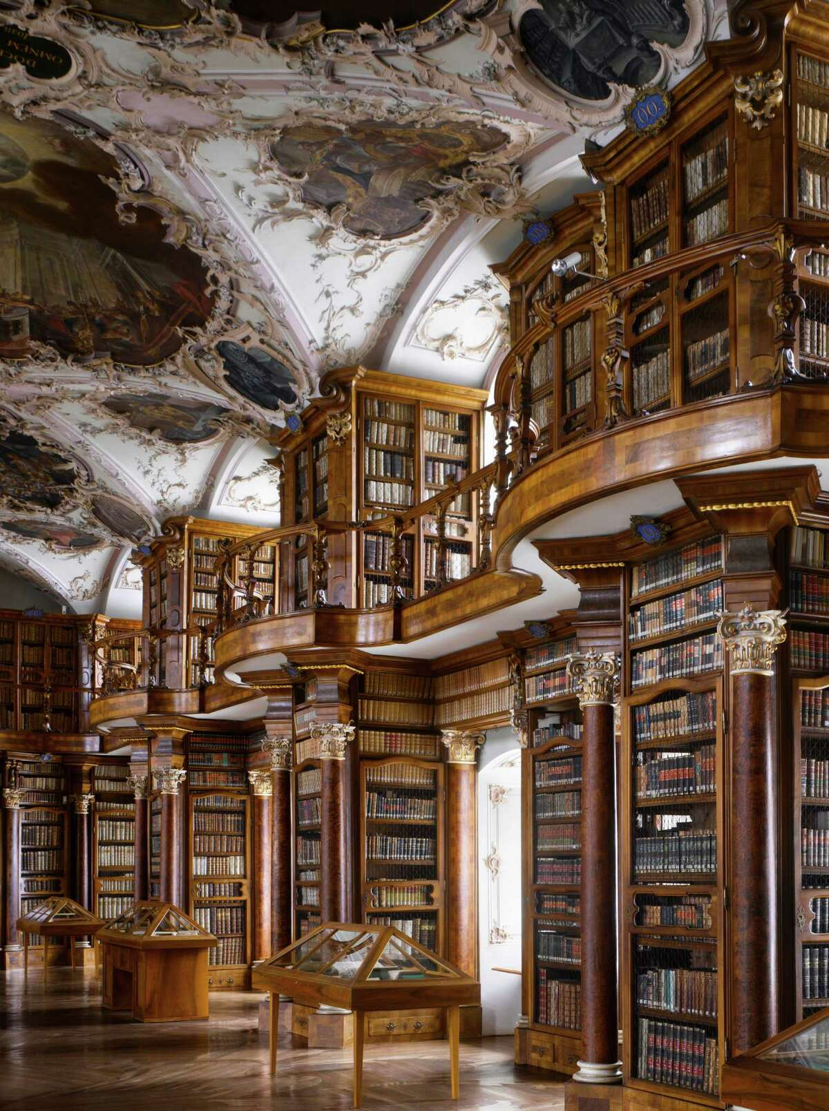Abbey of St Gall Library, 1763. St Gallen, Switzerland. The library has many forms of decoration, including putti in niches above the cases, representing the mechanical disciplines and the fine arts.From