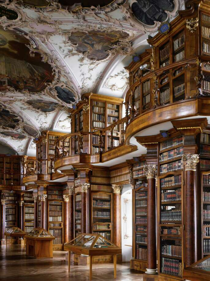 "Abbey of St Gall Library, 1763. St Gallen, Switzerland. The library has many forms of decoration, including putti in niches above the cases, representing the mechanical disciplines and the fine arts.From ""The Library: A World History"" by Cambridge University architectural historian James Campbell and photographer Will Pryce. Photo: Will Pryce / This picture can only be used with prior permission and/or agreement of fees with Will Pryce."