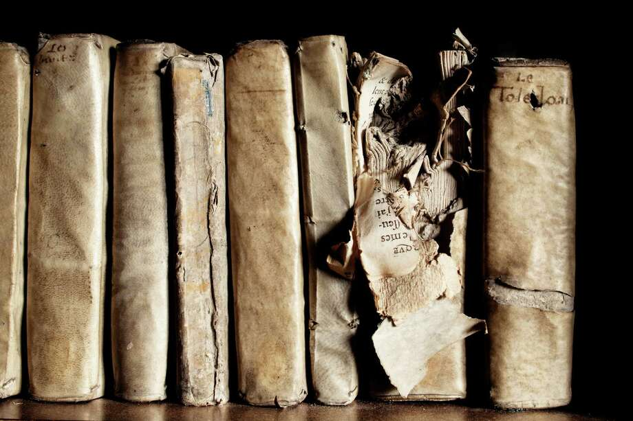 """Bomb-damaged books in the chapter library, Noyon Cathedral. France, 1506-7.From """"The Library: A World History"""" by Cambridge University architectural historian James Campbell and photographer Will Pryce. Photo: Will Pryce / This picture can only be used with prior permission and/or agreement of fees with Will Pryce."""
